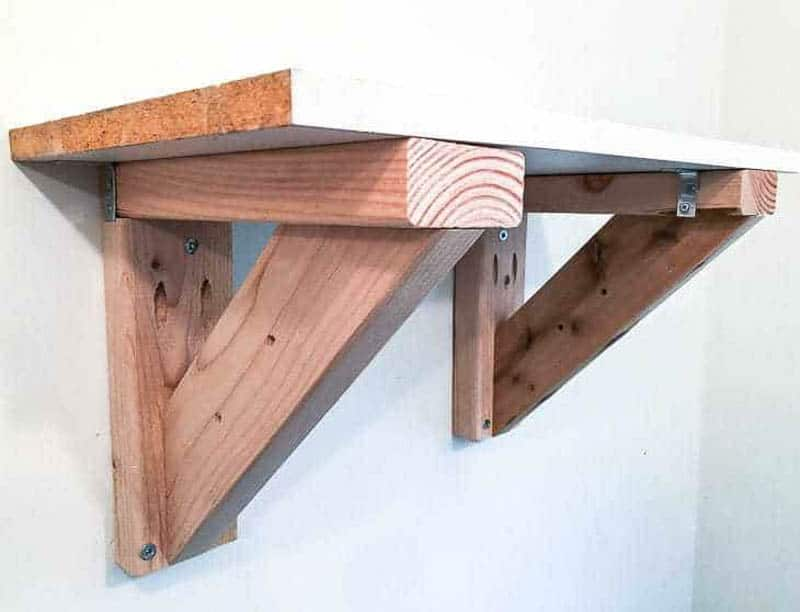 garden tool storage rack attached to the wall