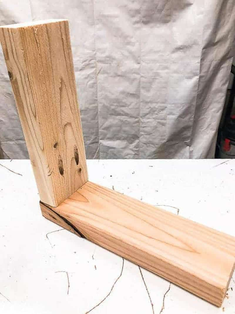 Bracket for garden tool storage rack made from wood