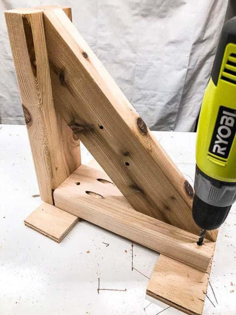 drilling holes for screws in garden tool storage rack