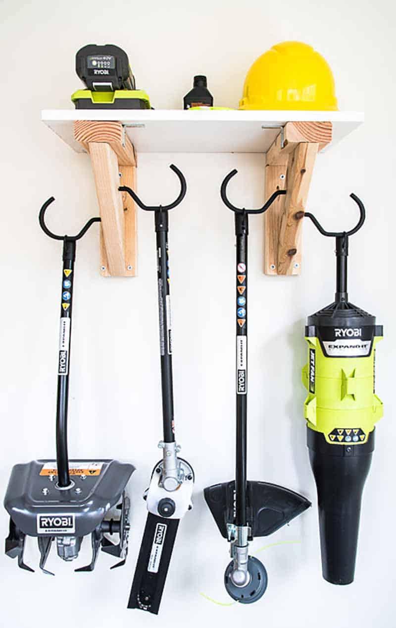 garden tools hanging from garden tool storage rack