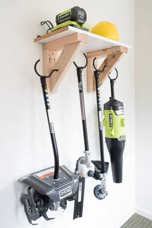 Keep your garage or shed floor clear by getting the tools up on the wall! This simple garden tool storage rack can hold them all!