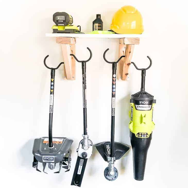 Get your tools off the floor and on the wall with this simple garden tool storage rack!