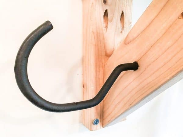 Use extra large bicycle hooks on your garden tool storage rack to customize the spacing between tools.