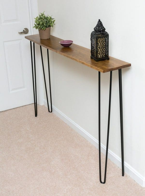 All you need are hairpin legs and a single board to make this console table by By Brittany Goldwyn!
