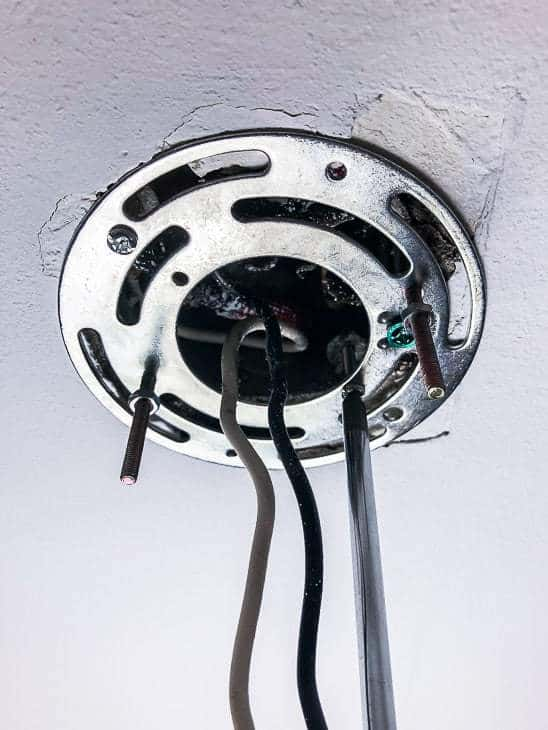 Attach the mounting plate for your kitchen track lighting to the junction box.