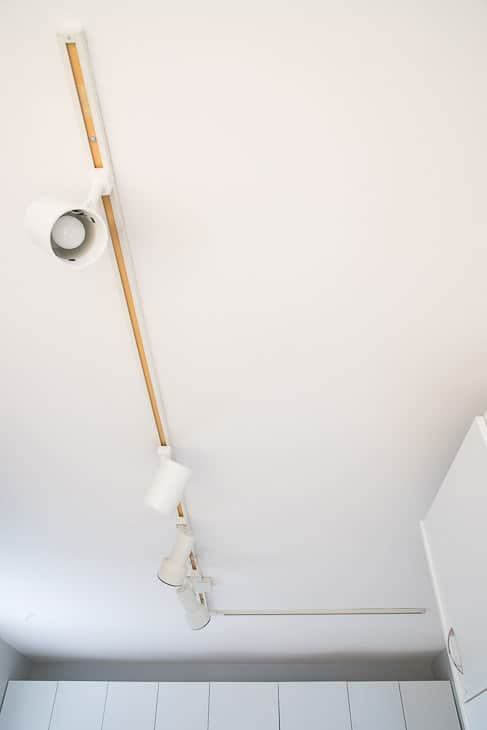 Our old kitchen track lighting was dated and failing. Check out how I installed new, modern track lighting that makes a huge difference in our kitchen!