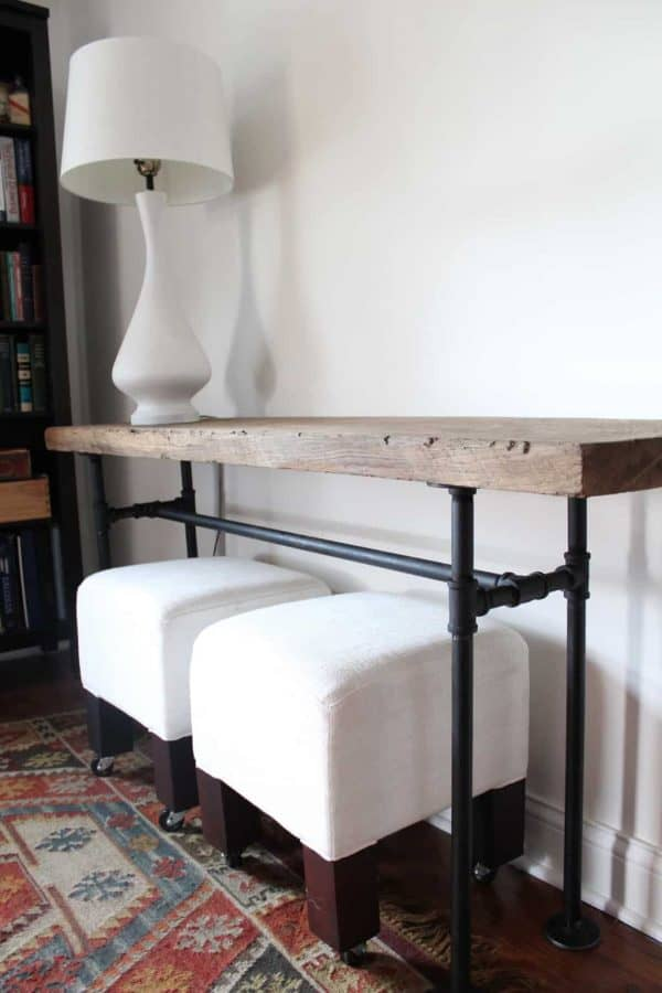 All you need is pipe and a gorgeous slab of reclaimed wood to create this console table from Handmaid Tale