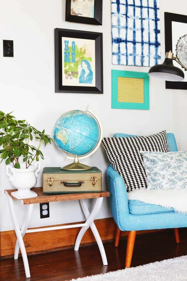 DIY leather side table next to blue chair