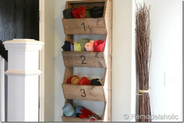 wooden bins mounted to the wall for storage