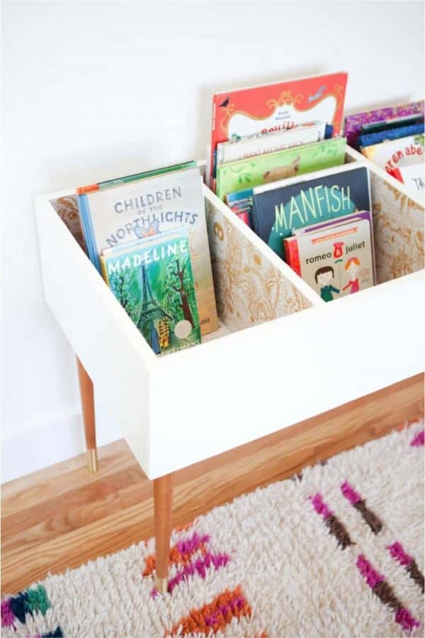 wood bin filled with childrens books