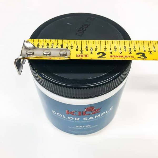 measuring tape with small jar of paint
