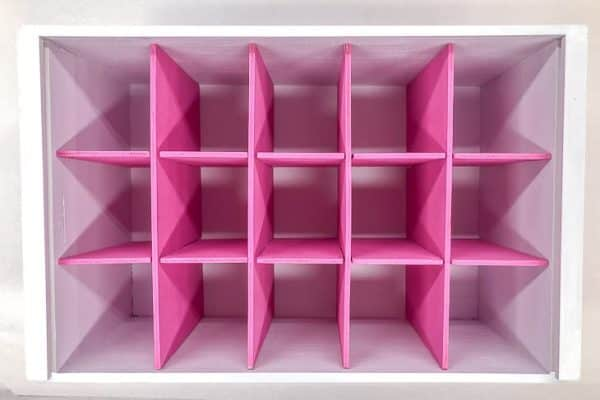 white box with pink box dividers arranged in a grid