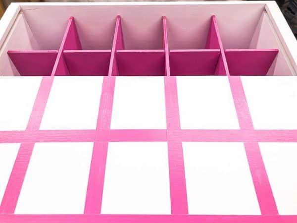 white box with pink box dividers, and white lid with pink grid painted on top