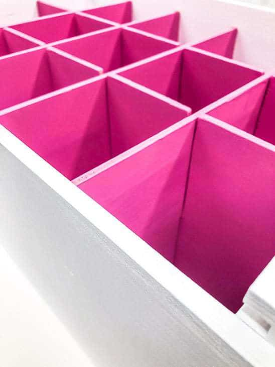white box with bright pink box dividers