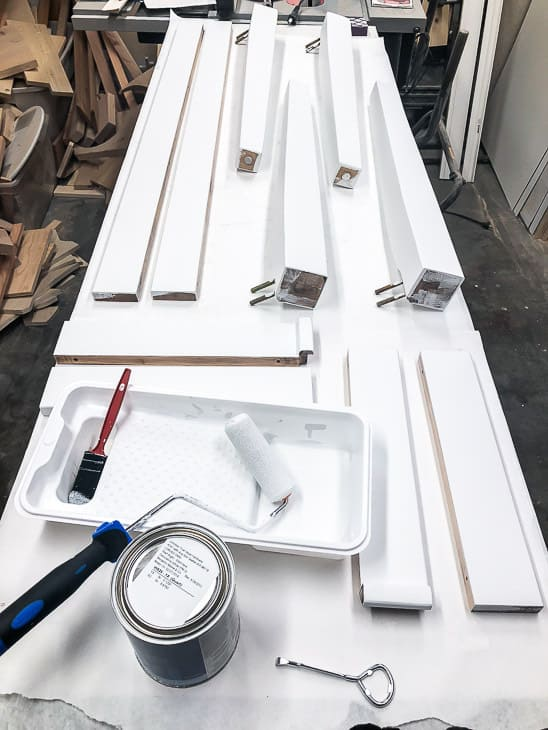 table pieces on a workbench being painted white