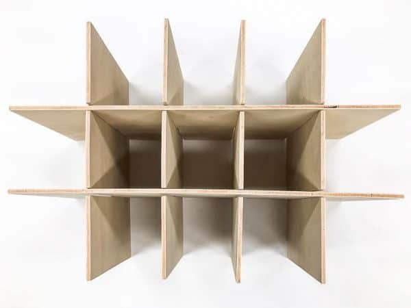 grid of plywood pieces used as box dividers