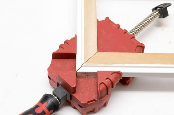corner clamp holding trim pieces together