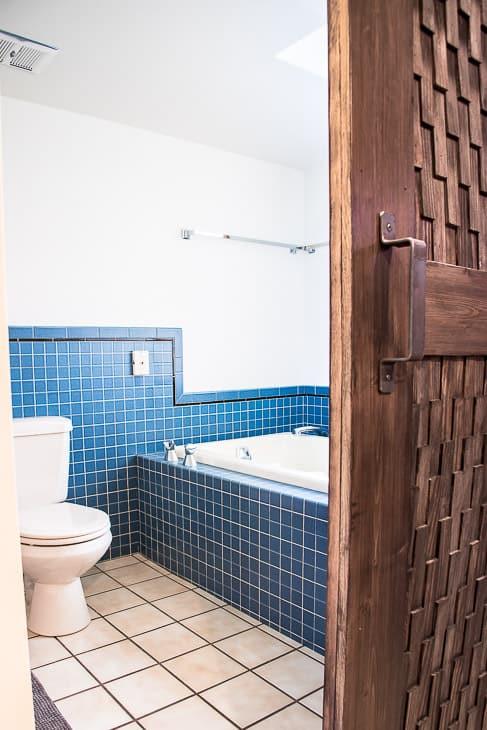 bathroom with almond fixtures behind barn door