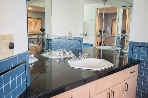 bathroom vanity with hexagon sink and multiple mirrors
