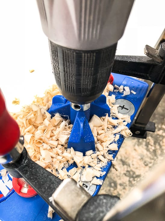 drilling a concealed hinge hole with a concealed hinge jig and bit