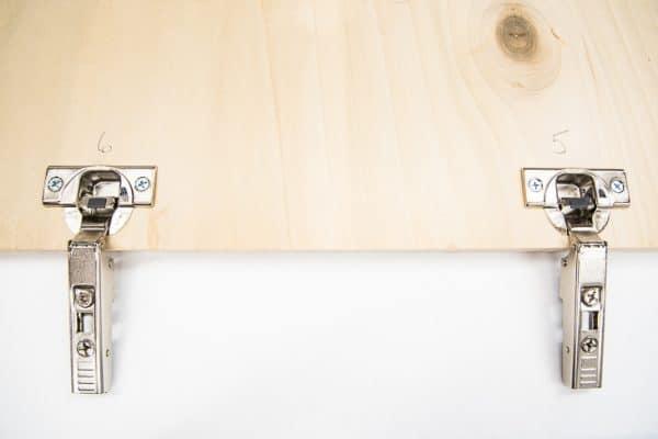 testing the spacing of a concealed hinge jig on plywood