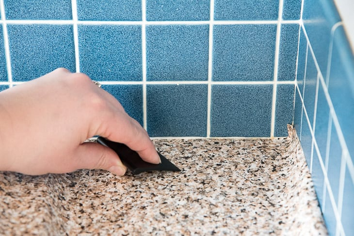 smoothing out air bubbles when applying countertop contact paper