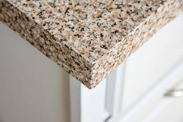 contact paper kitchen counter with wear on corner
