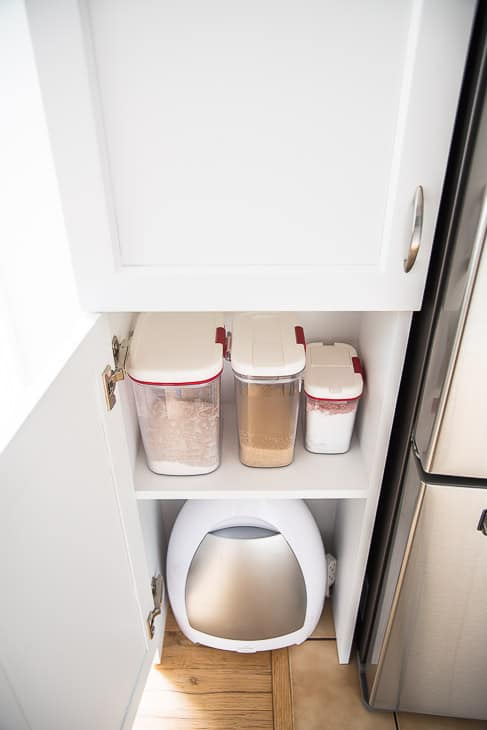 pantry with baking supplies and automatic vacuum