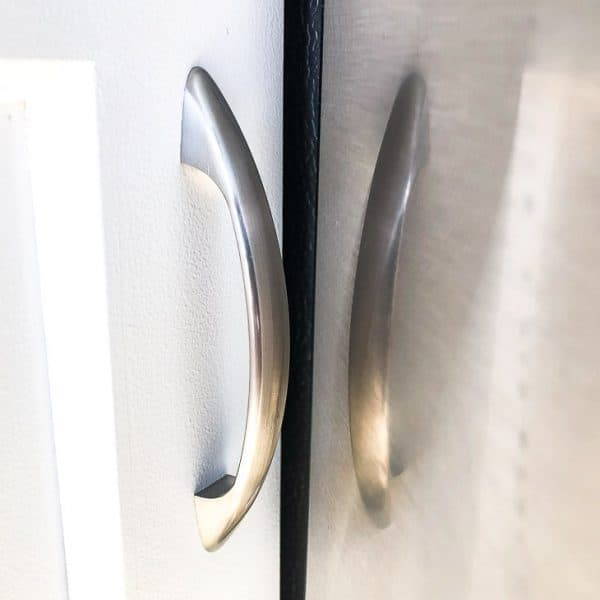 cabinet door handle and refrigerator door with small space in between