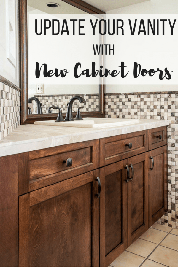 "bathroom vanity with dark brown cabinet doors, limestone countertop and stone mosaic backsplash with text overlay reading ""Update Your Vanity with New Cabinet Doors"""