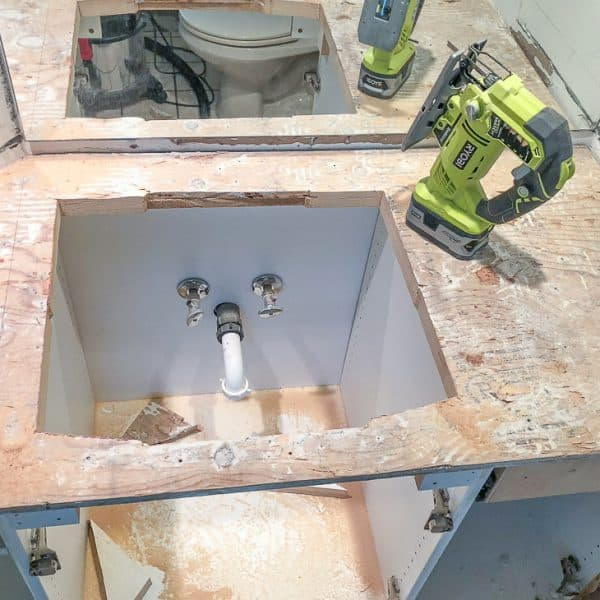 sink hole cut into plywood top of bathroom vanity