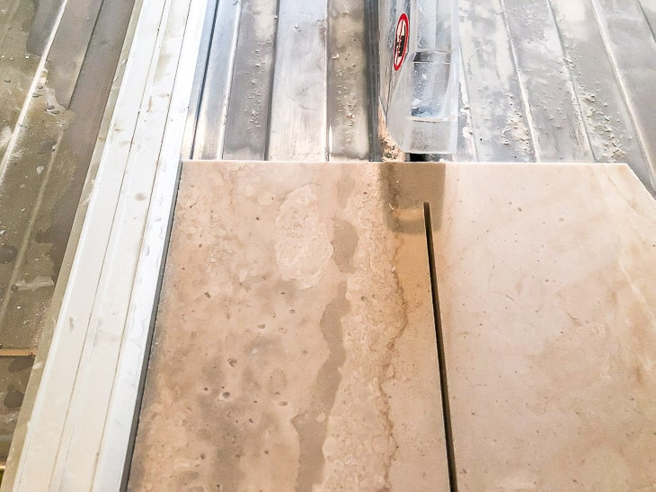 cutting limestone tile on a tile saw