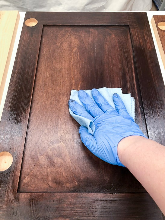wiping excess General Finishes Java Gel stain off of new cabinet doors