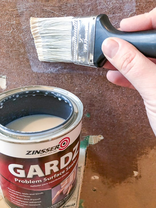 applying Gardz Problem Surface Sealer to torn drywall paper