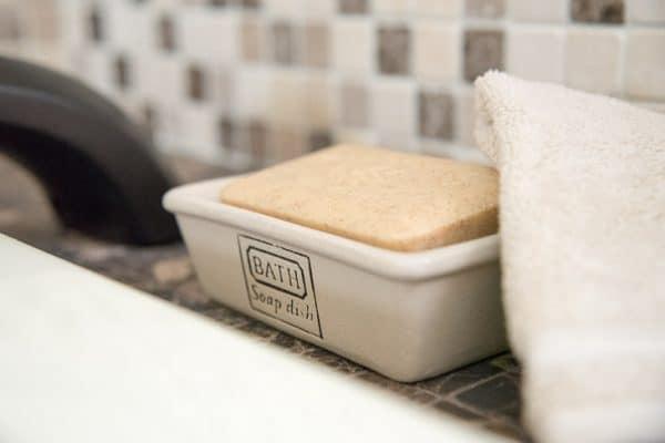 fancy bath soap in soap dish with washcloth