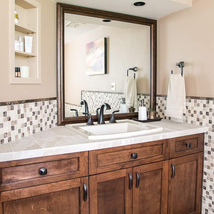custom framed mirror over bathroom vanity