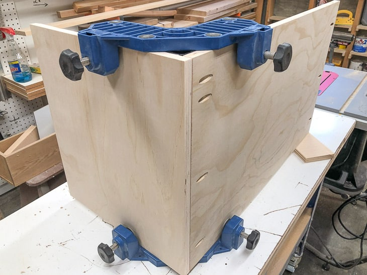 building a DIY entryway bench with corner clamps holding pieces together