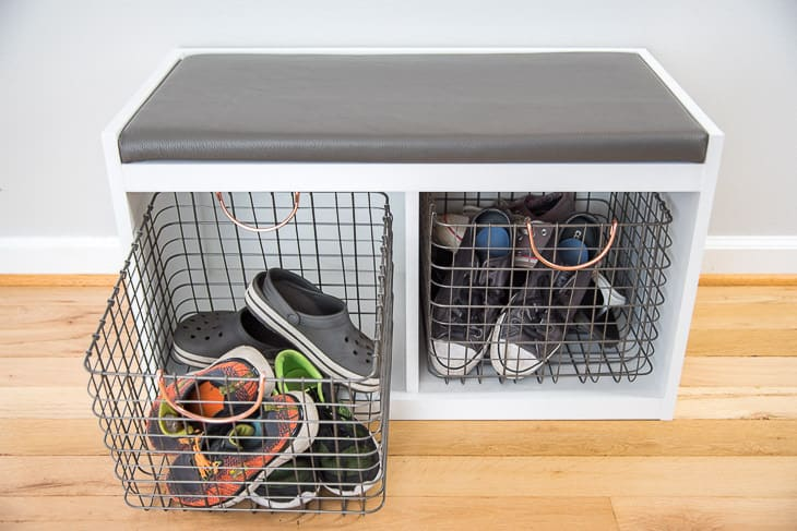 DIY entryway bench with metal bin pulled out and filled with shoes