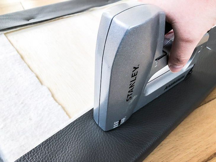 stapling leather to back of DIY entryway bench cushion