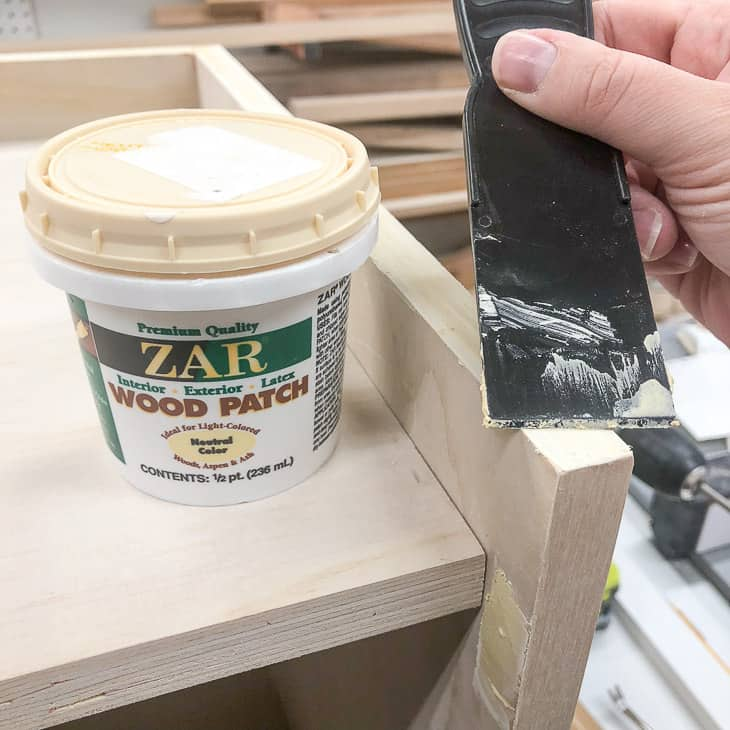 applying wood filler to exposed plywood edges