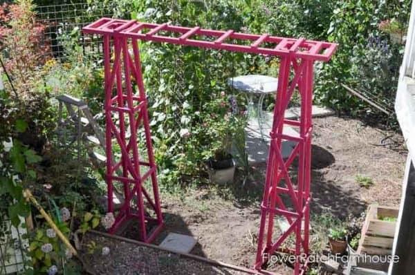 two garden obelisks connected together to form a DIY arbor