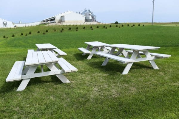 four whitewashed picnic tables