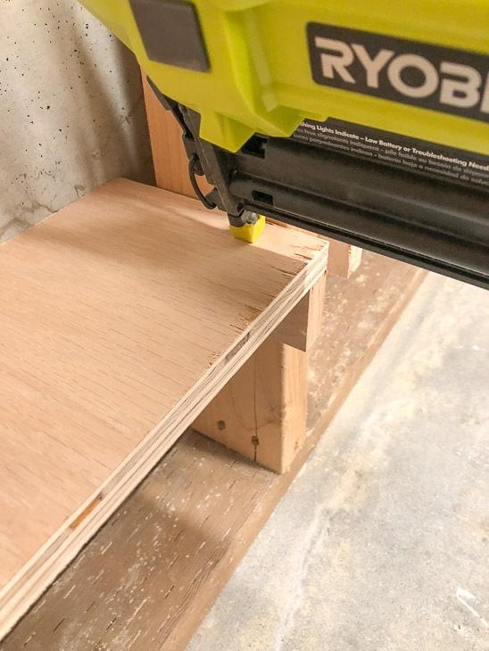 nailing shelf to top of shelf brackets