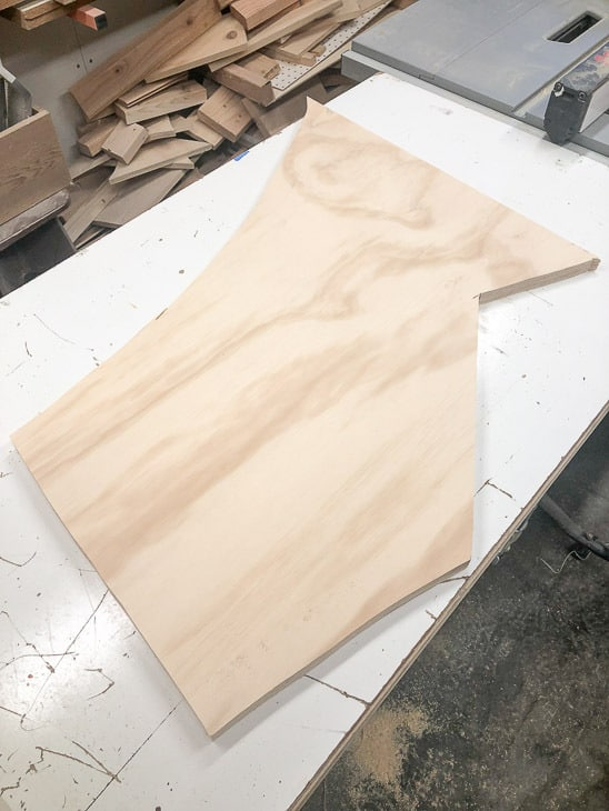 oddly shaped plywood scrap to be cut into between the studs shelving