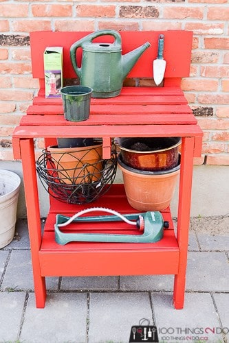 red DIY potting bench made from pallets