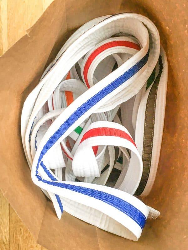 martial arts belts in paper bag