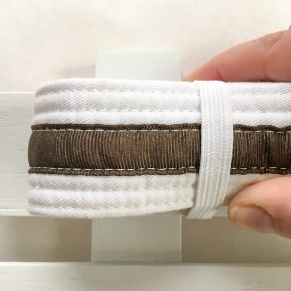 wrapping elastic around martial arts belt for display
