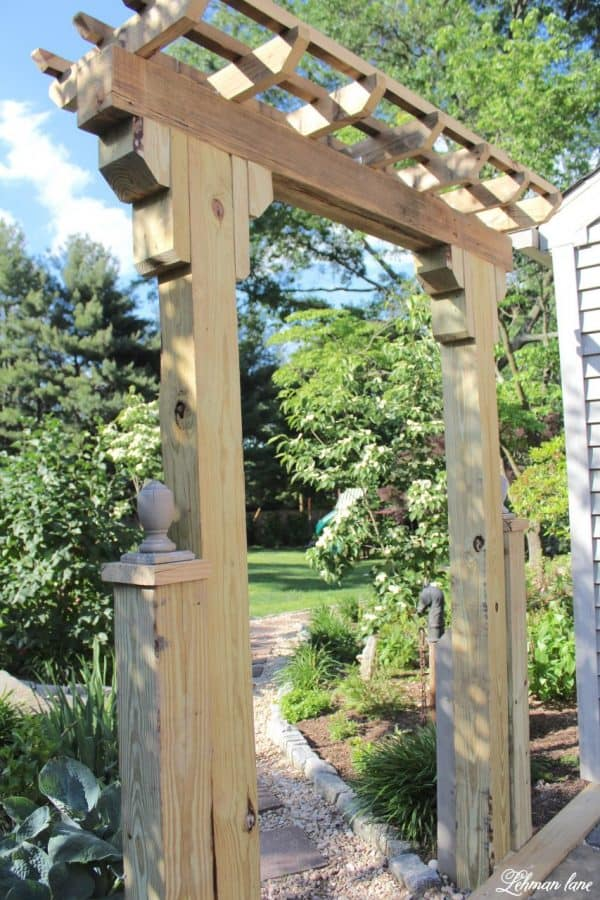 DIY wooden arbor entryway to garden