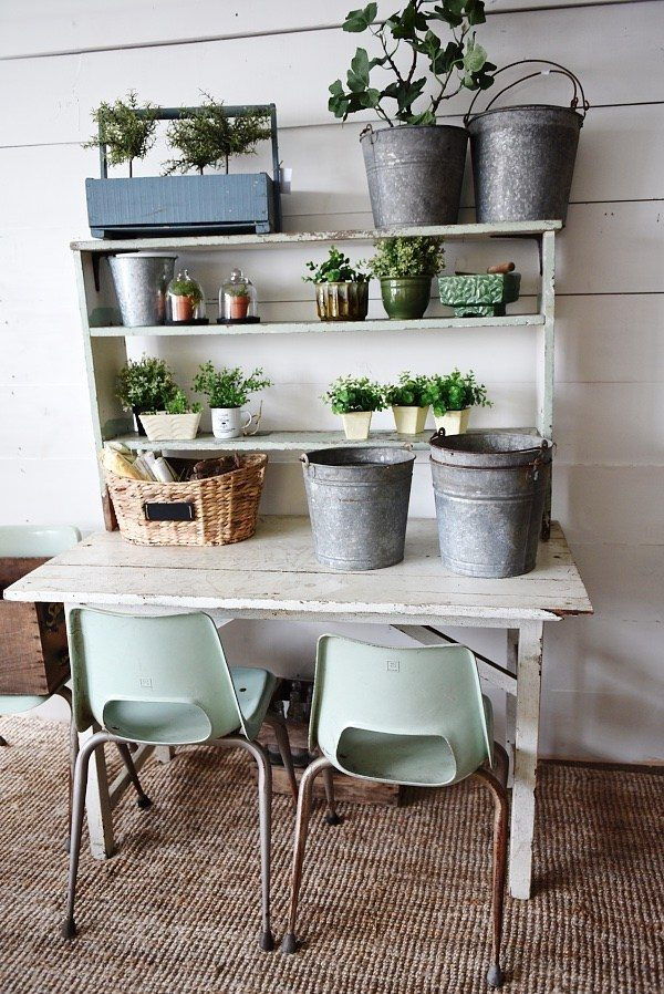 DIY potting bench made from old table and shelving unit.