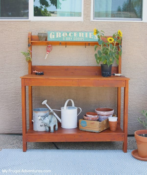 simple DIY potting bench with flowers on top